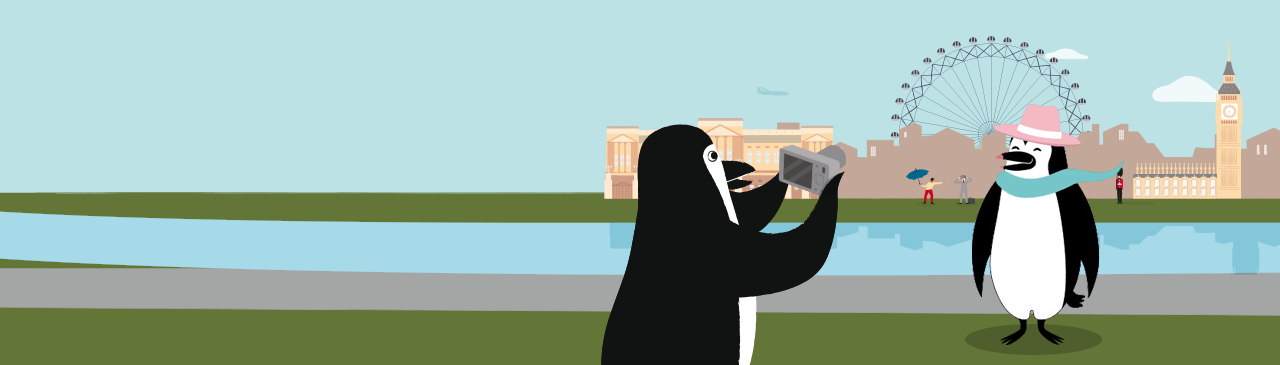 Percy Penguin takes a photo of his wife, Penny Penguin, on their vacation.